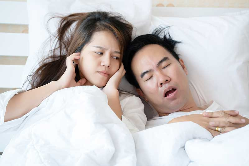 Sleep-apnea-couple-snoring